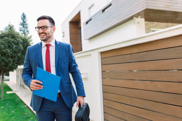 Smiling modern young businessman going to work