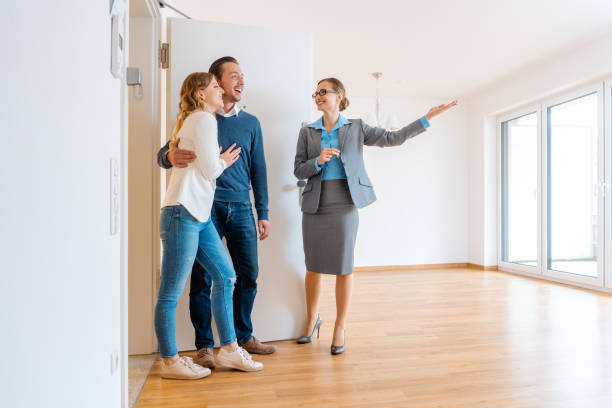 female realtor with young couple